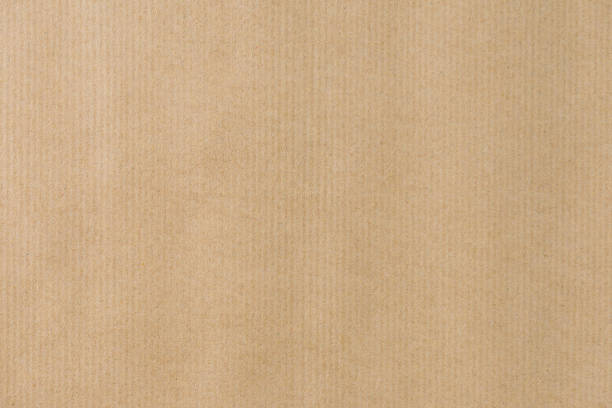 Brown striped recycle paper texture for wraping. Kraft paper stock photo