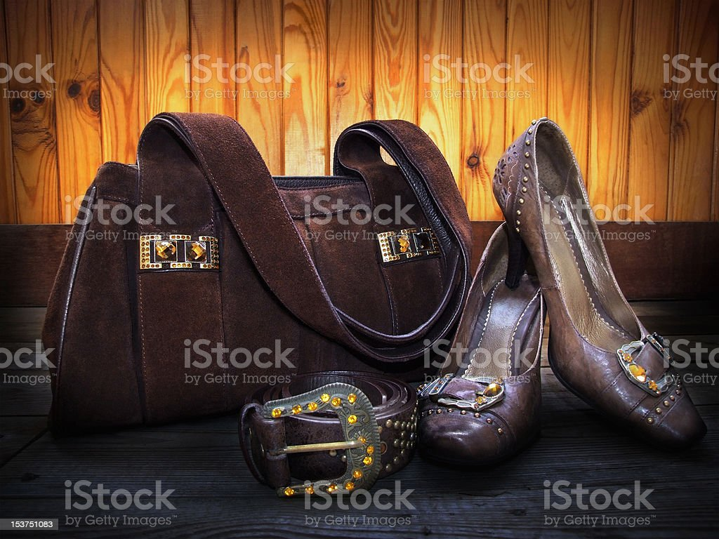 Brown suede bag, leather shoes and belt stock photo