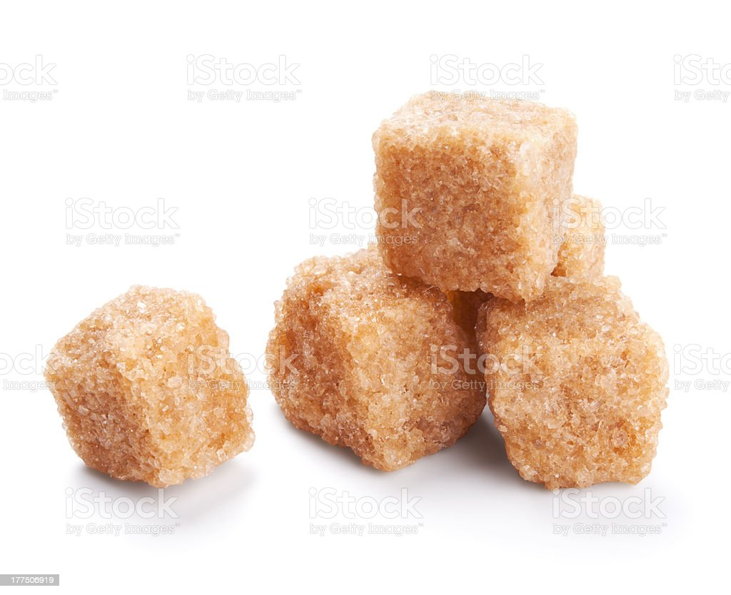 brown sugar cubes isolated on white stock photo