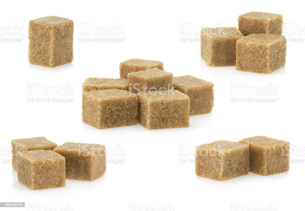 brown sugar cubes on white stock photo