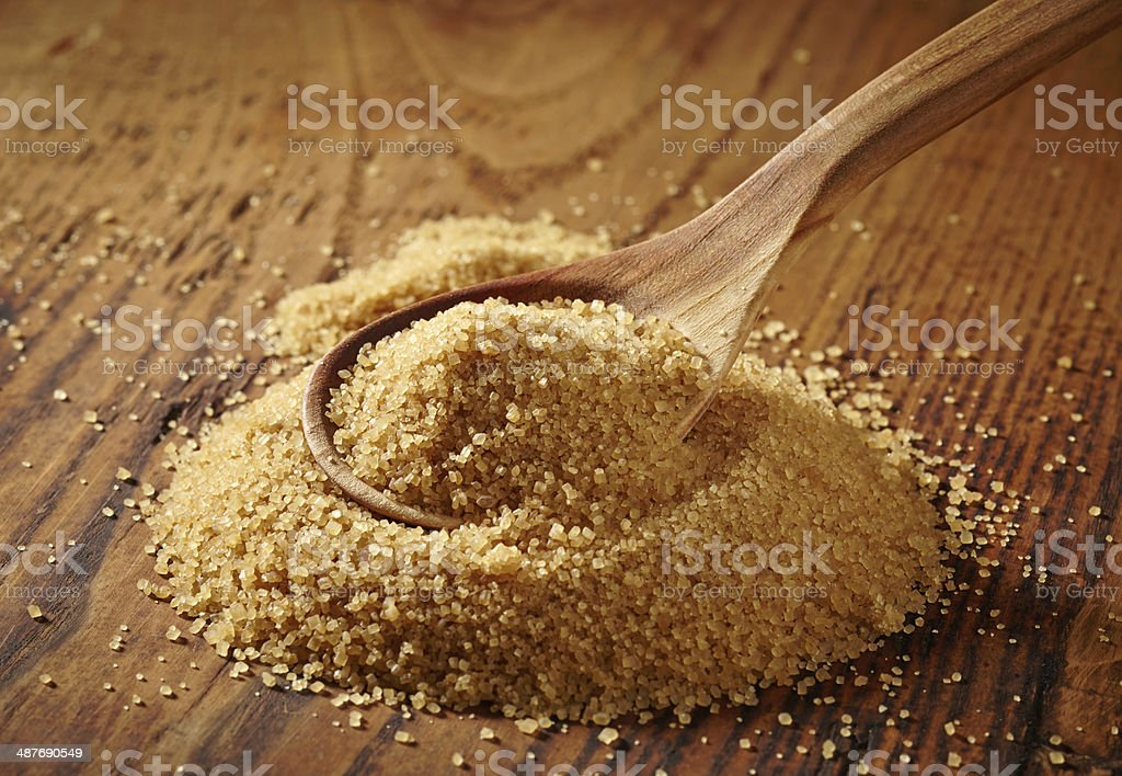 brown sugar heap on wooden table stock photo