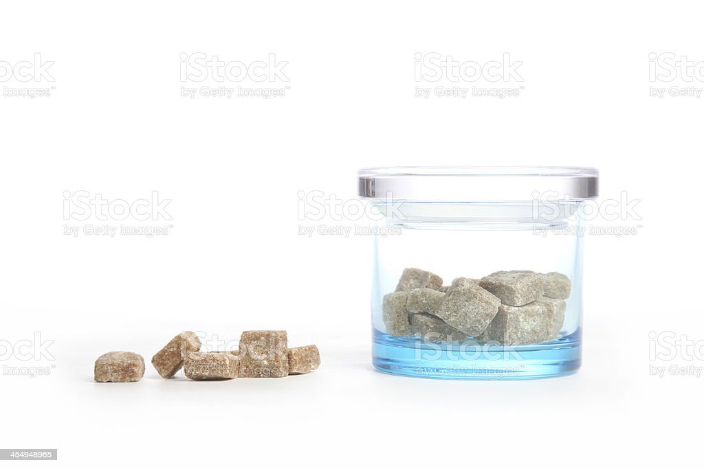 Brown sugar next to jar with it royalty-free stock photo