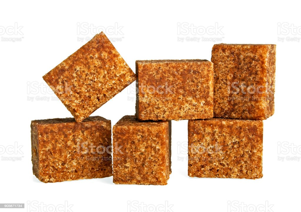 Brown sugar on a white background stock photo
