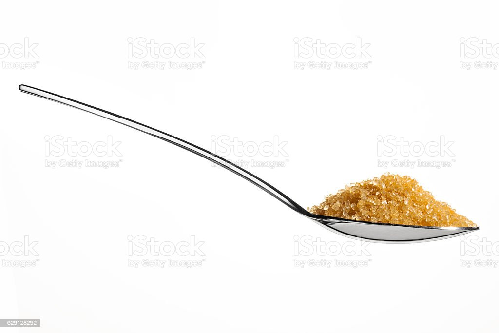 Brown sugar on teaspoon stock photo