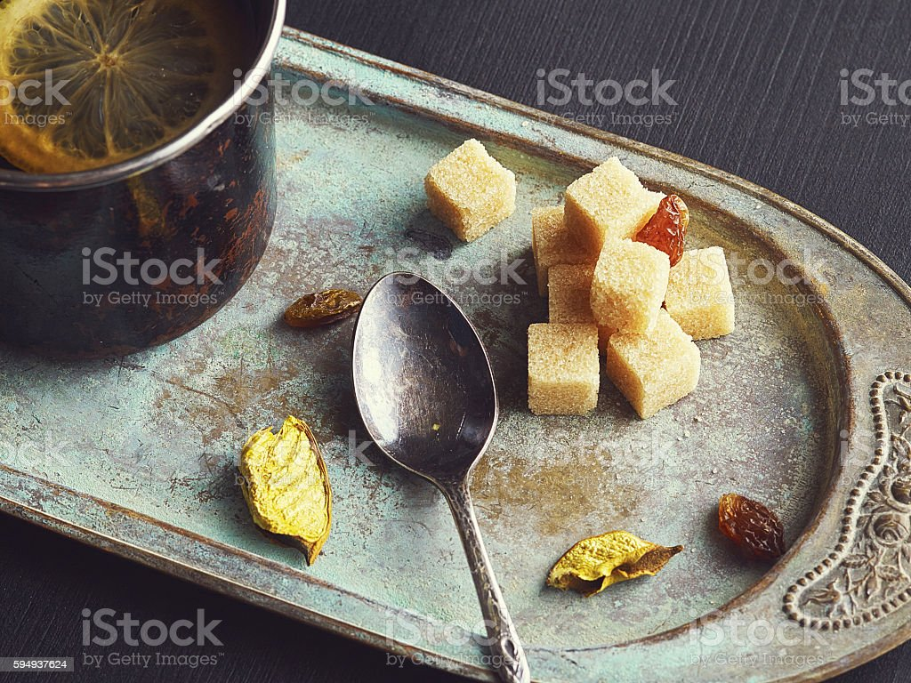Brown sugar on very old rustic tray. stock photo