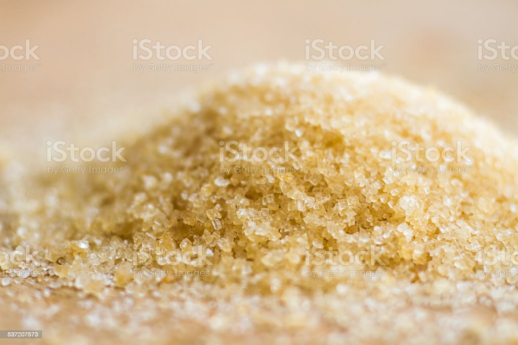 Brown sugar on wooden tables stock photo