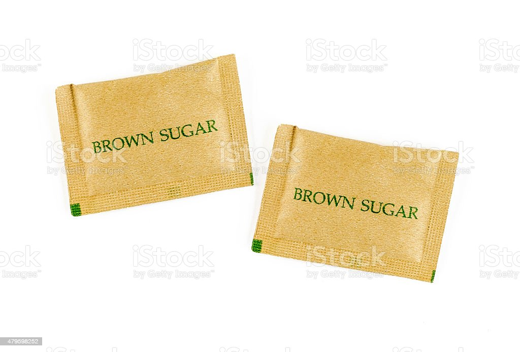 brown sugar sachet isolated on white background stock photo
