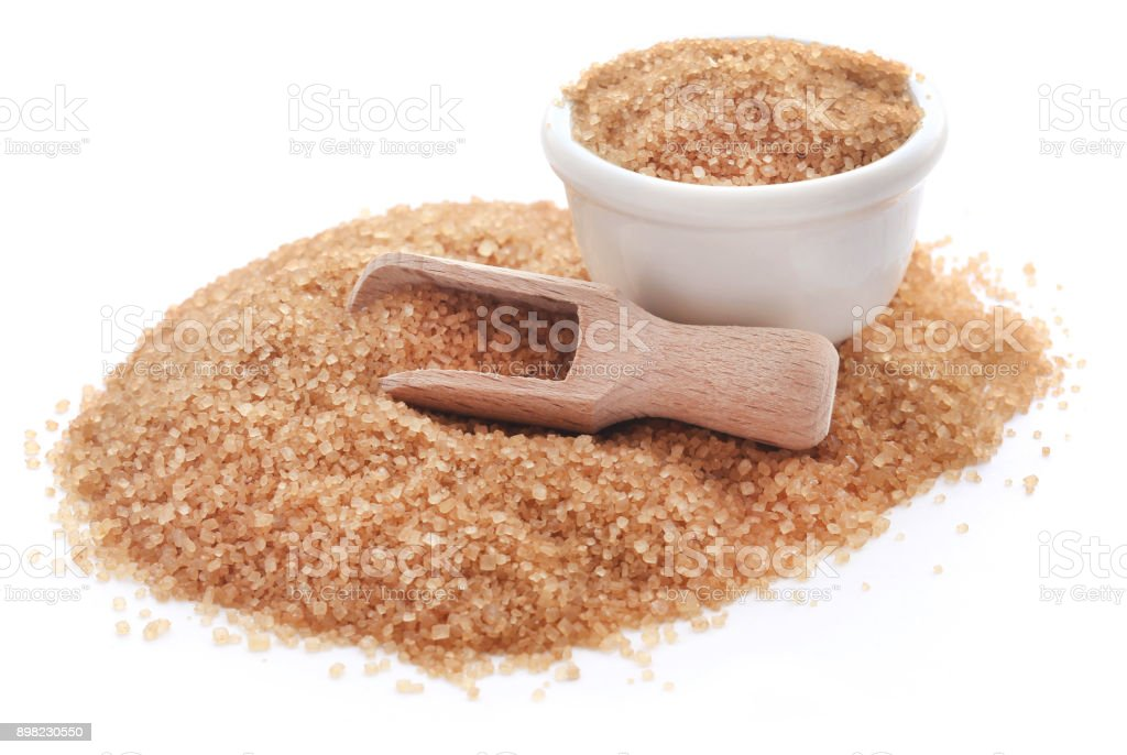 Brown sugar with wooden scoop stock photo