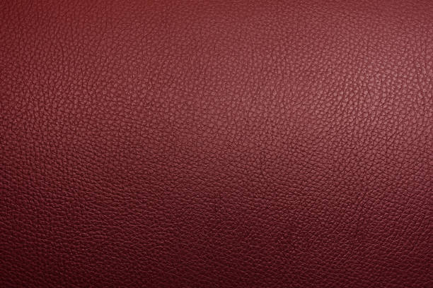 Brown tan cheery red guinuine leather texture background abstract style.
