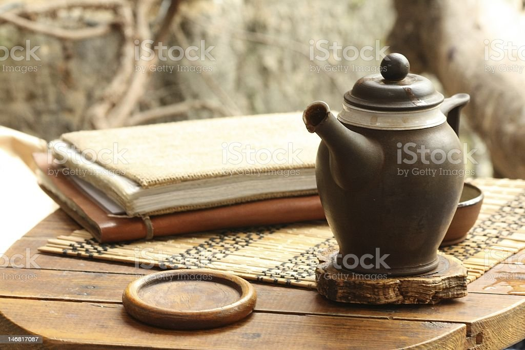 Brown teapot on wooden small table royalty-free stock photo
