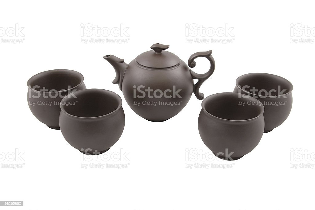 brown teapot with four bowls royalty-free stock photo