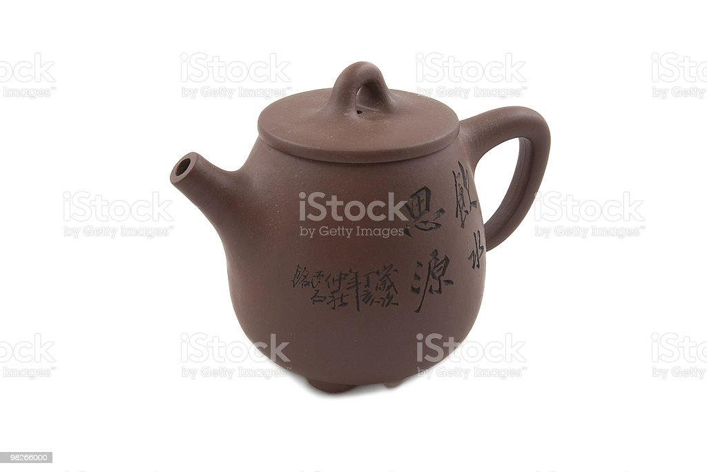brown teapot with hieroglyphic ornament royalty-free stock photo