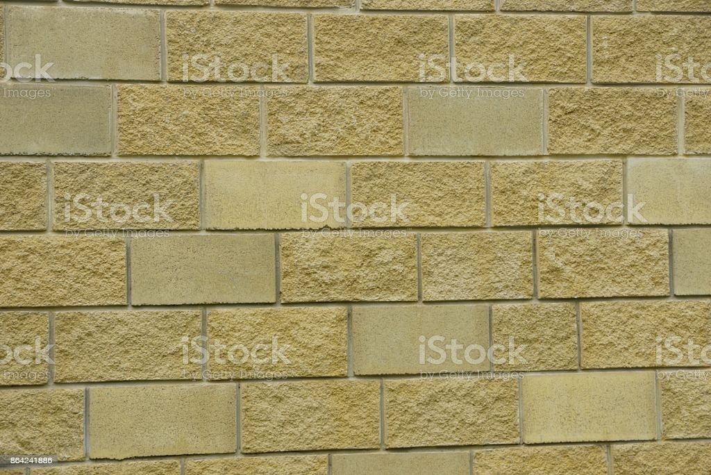 brown texture from a fragment of brickwork on the wall of the house royalty-free stock photo