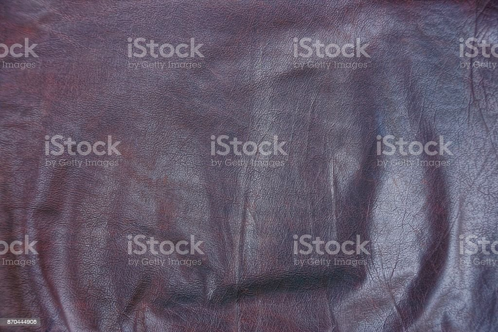 brown texture of crumpled leather from a piece of clothing stock photo