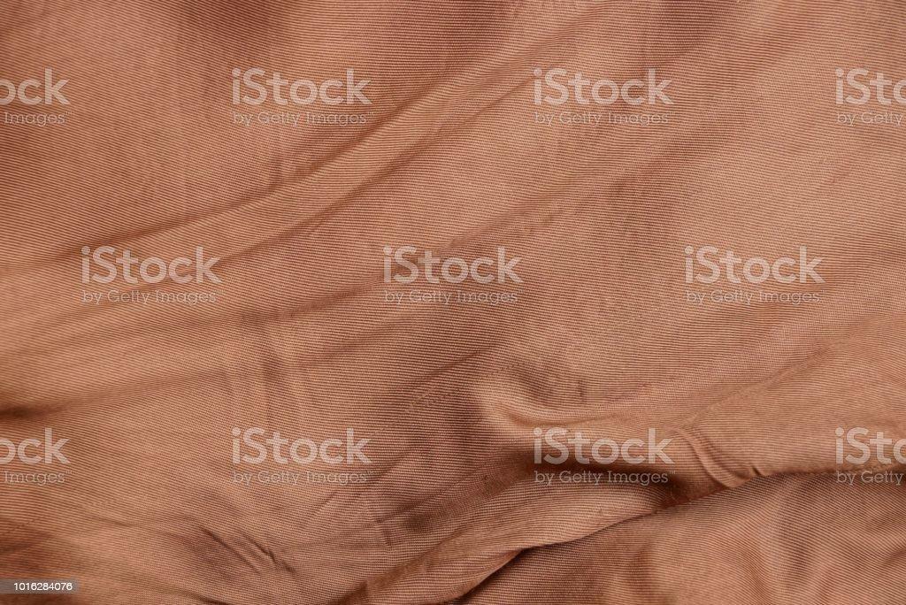 布のしわの部分から生地の茶色の質感 ストックフォト