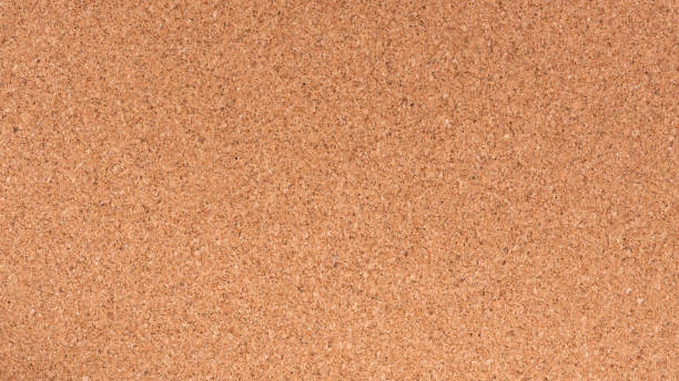 Brown textured cork board closeup for notes stock photo