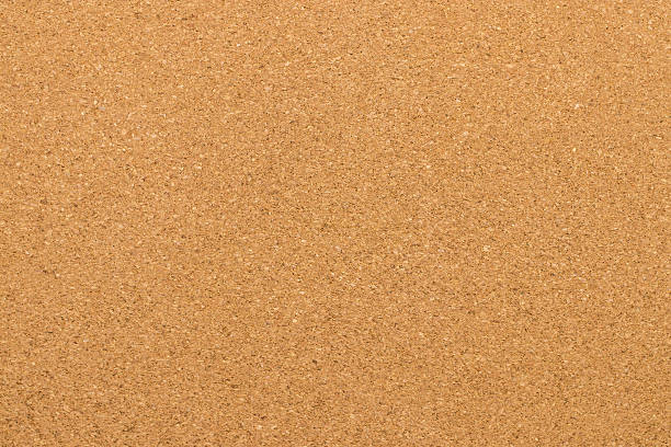 brown textured cork - closeup for background - korkwand stock-fotos und bilder