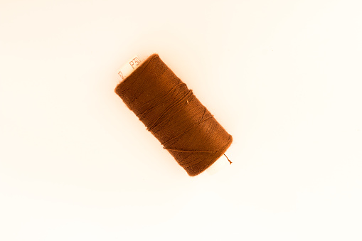 a brown thread , handmade tool