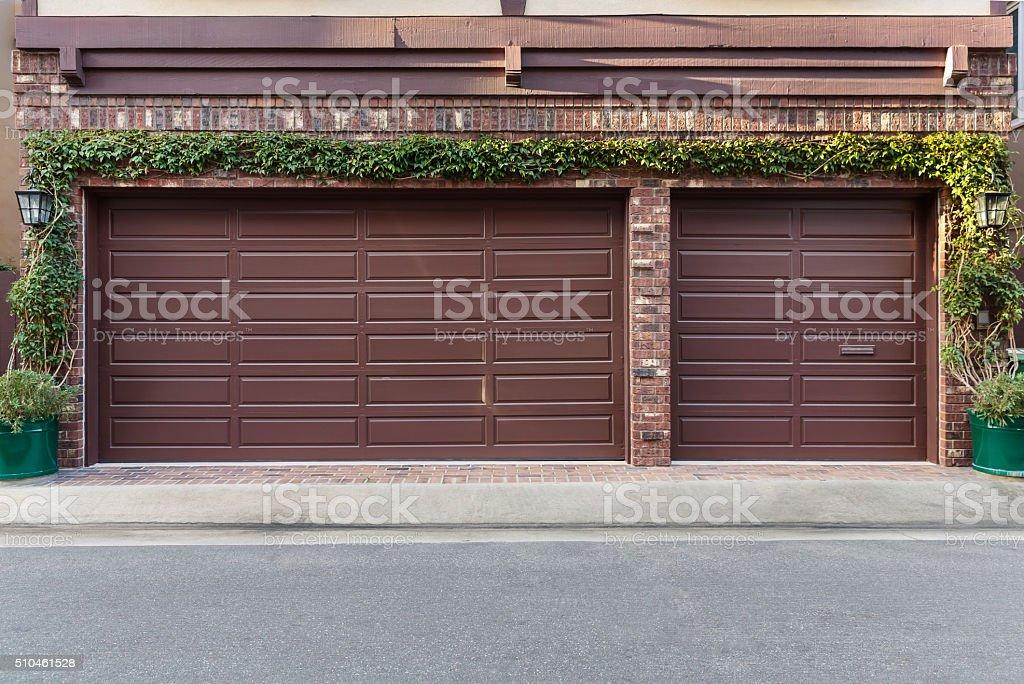 Brown three car garage stock photo