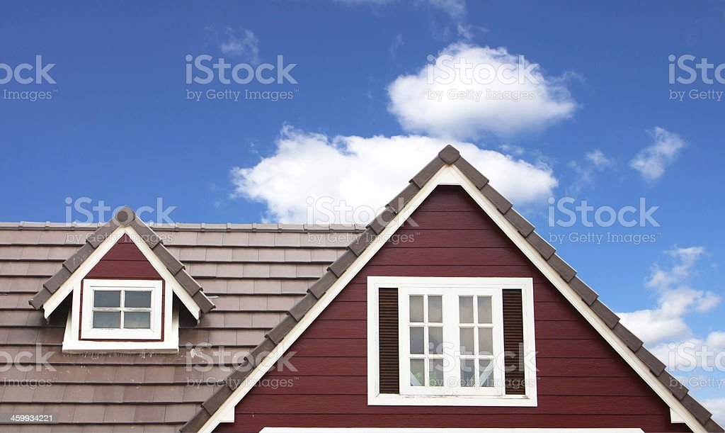 Brown tile roof in garden against stock photo