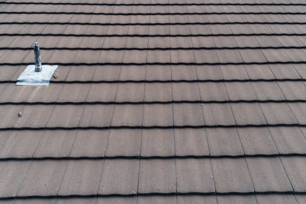 Brown tiles on a residential roof stock photo