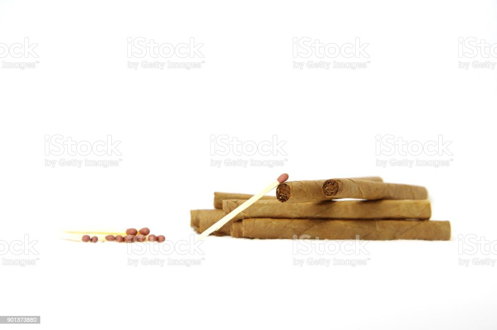 brown tobacco and match addition drug on white background stock photo