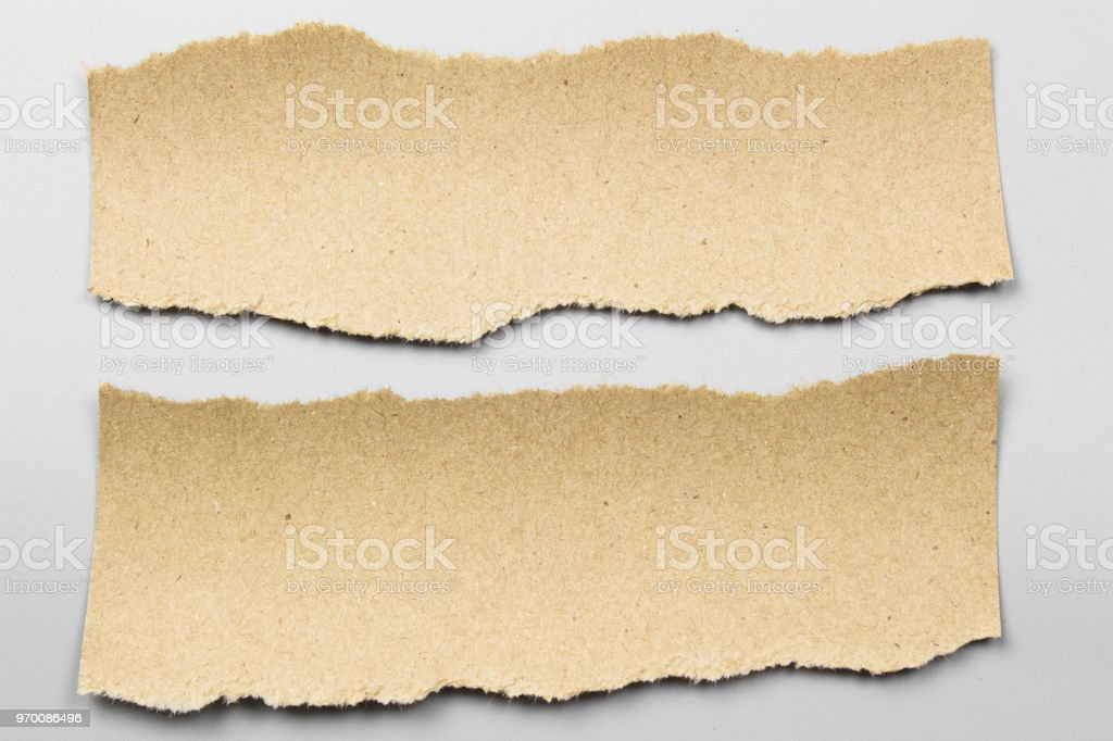 Brown torn paper on gray background. collection paper rip.