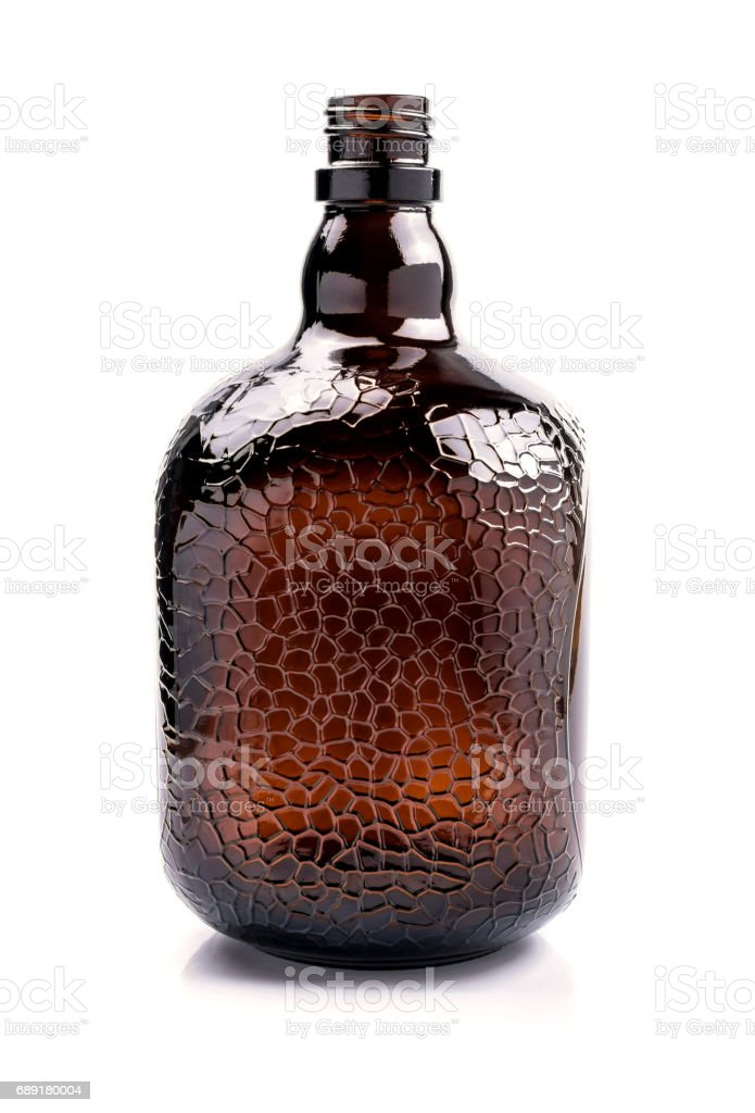 Brown transparent glass bottle, isolated on white. stock photo