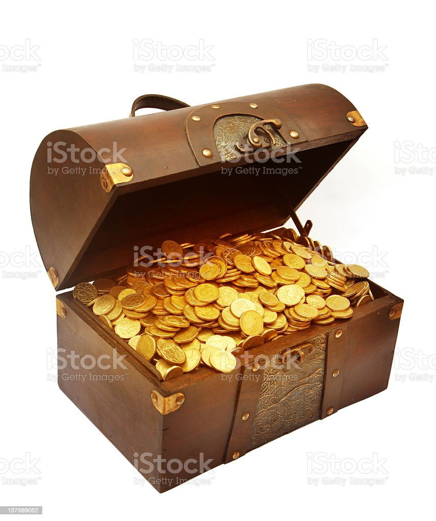 A brown treasure chest filled with dozens of gold coins stock photo