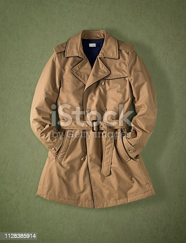 Brown trench coat isolated on green background (with clipping path)