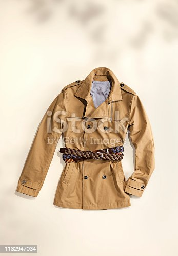 Brown trench coat isolated on white background (with clipping path)