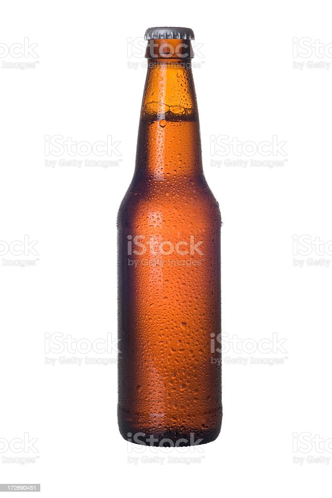 Brown unlabeled beer bottle with condensation on white royalty-free stock photo