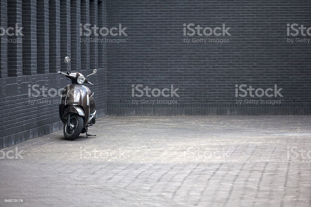 Brown vintage scooter in a modern building. stock photo