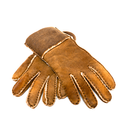 Brown warm fur suede gloves isolated on white background, winter equipe. High quality photo