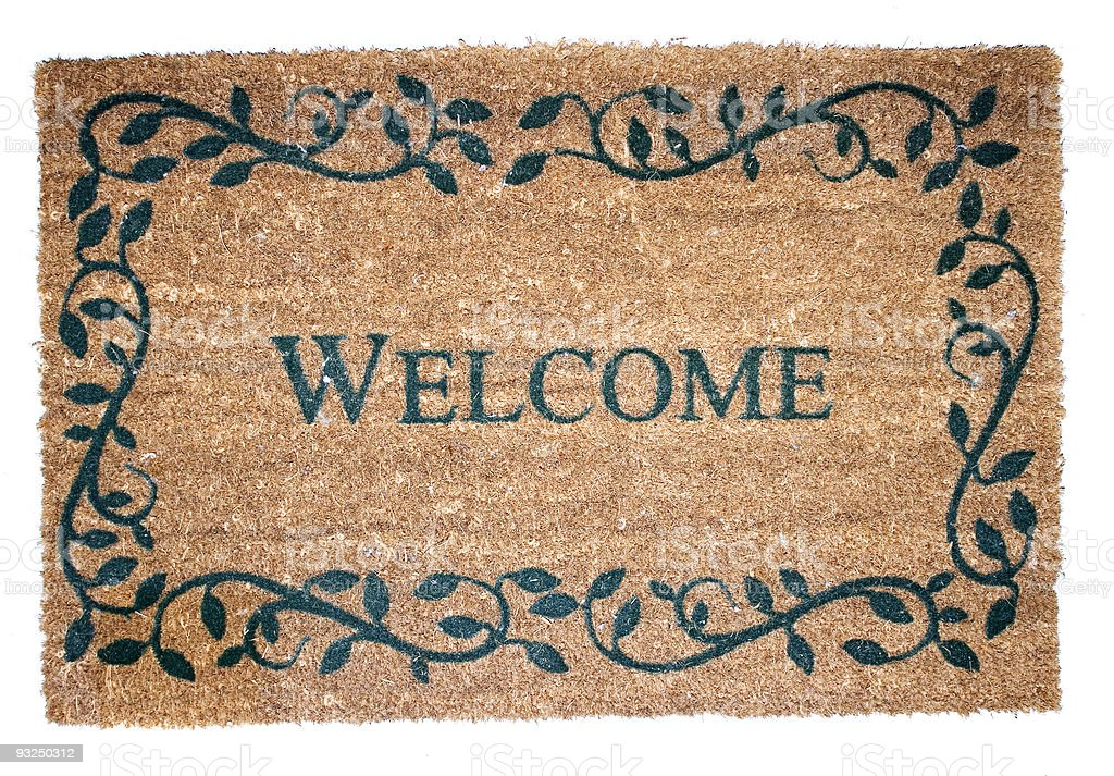 Brown welcome mat with black vine decoration stock photo