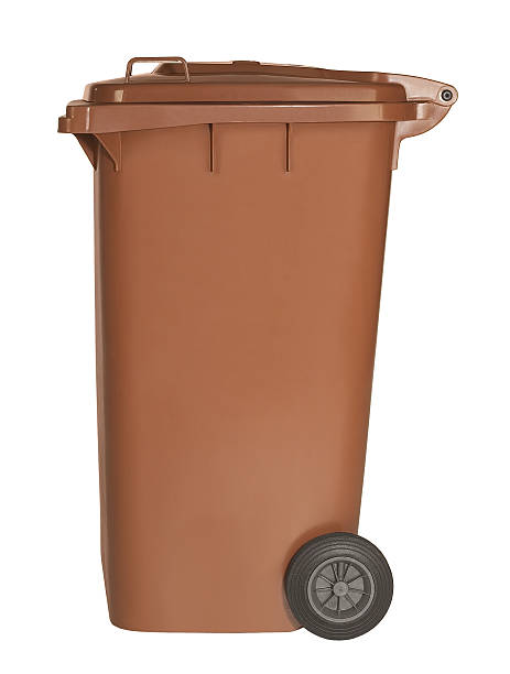 Brown wheeled garbage bin on white background stock photo