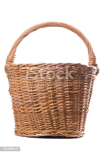 Traditional craftsman made brown wicker basket isolated on a white background. Studio shot.