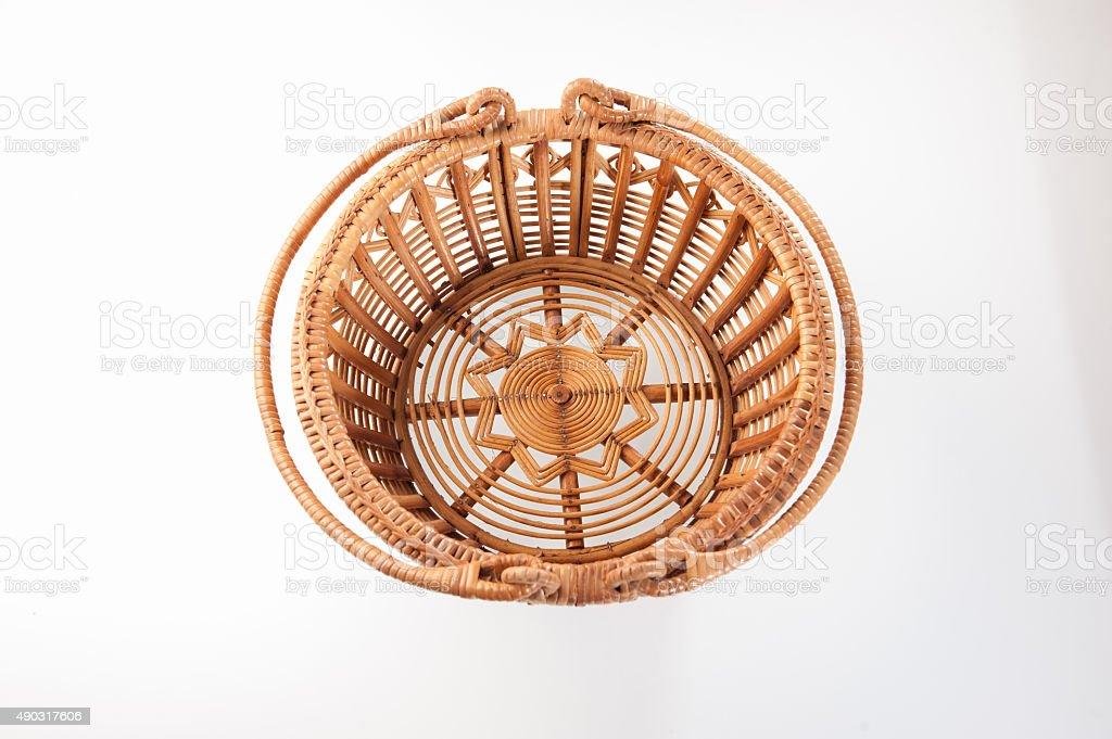 Brown wicker basket top view on white background stock photo