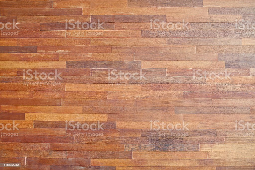 Brown wood background. Leaflets are arranged in a line. stock photo