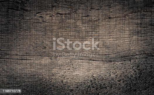 Old grunge dark textured wooden background. Top view with a vignette. Copy space in the center