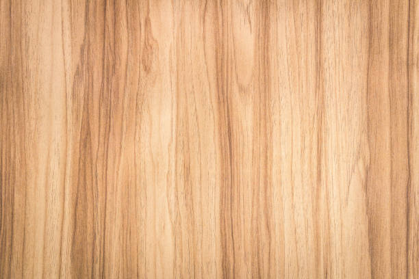Brown wood background with abstract pattern. Surface of natural wooden material. Brown wood background with abstract pattern. Surface of natural wooden material. beech tree stock pictures, royalty-free photos & images