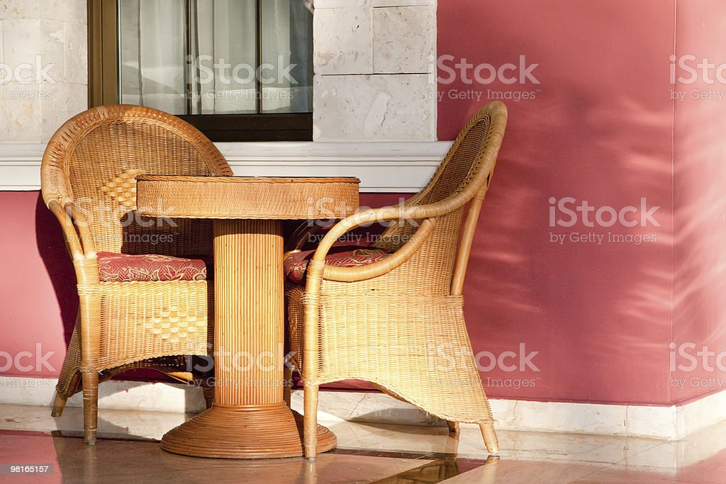 Brown wooden chairs an tables on patio royalty-free stock photo