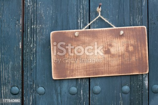 istock Brown wooden frame blank hanging on nail 177540880
