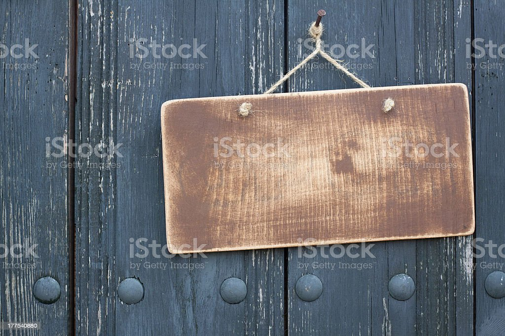 Brown wooden frame blank hanging on nail stock photo