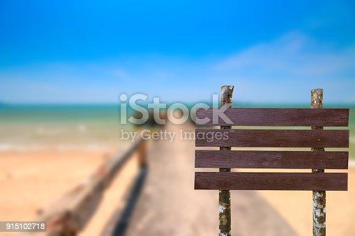 914465180istockphoto Brown wooden sing on blurred concrete bridge extend 915102718