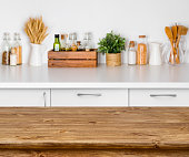 Brown wooden table with bokeh image of kitchen bench interior