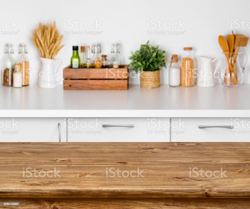 Brown wooden table with bokeh image of kitchen bench interior stock photo
