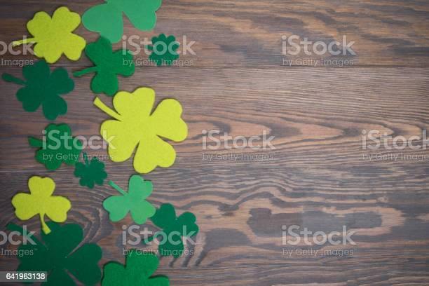 Brown wooden table with handmade green leaves of clover picture id641963138?b=1&k=6&m=641963138&s=612x612&h=c2yzjva88dtsh xa53xjgfd3fplte839diz6eyrl8ya=