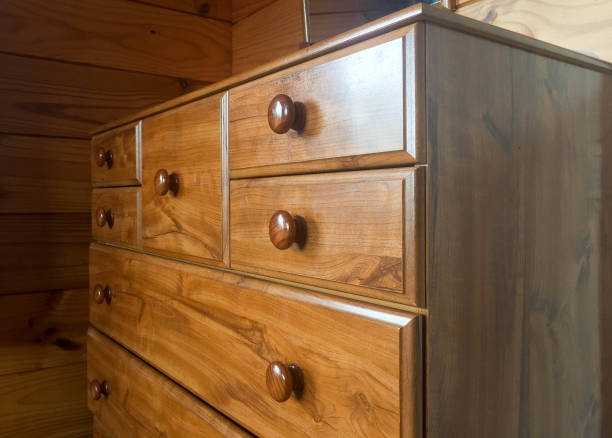 Brown wooden tall boy cabinet stock photo