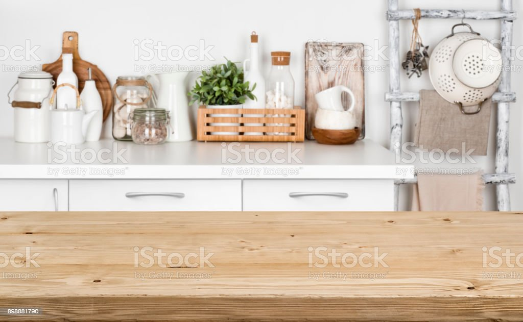 Brown wooden texture table over blurred image of kitchen bench stock photo